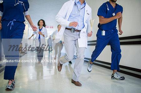 Doctors and nurses rushing in hospital hallway