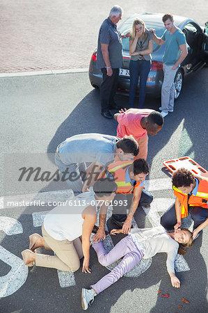People rushing to injured girl in street