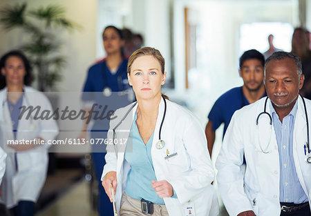 Doctors rushing in hospital hallway