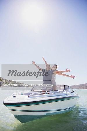 Couple playing on speedboat
