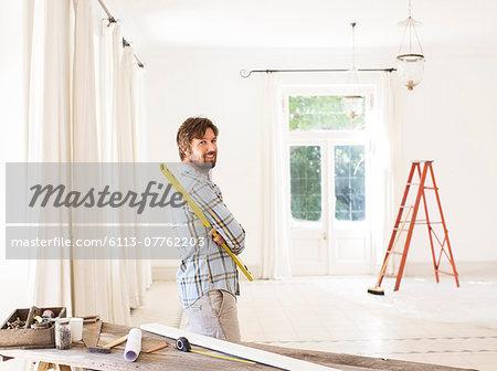 Man overlooking living space near construction materials