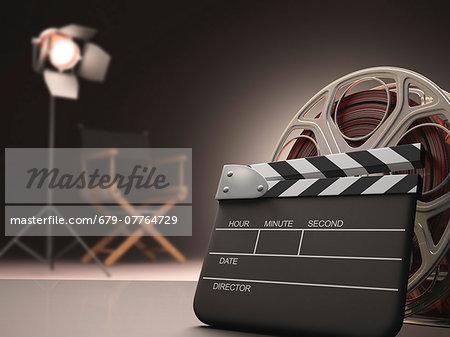 Clapperboard and cinema film reel, computer artwork.