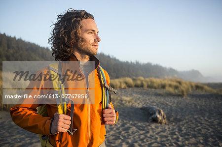 Man hiking near the ocean.