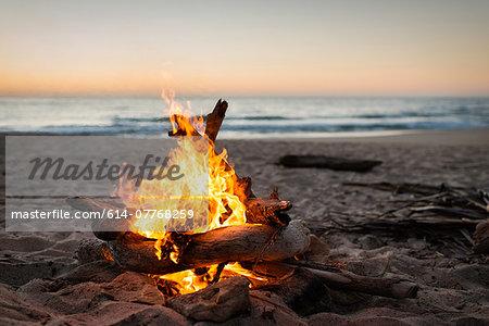 Bonfire burning on beach