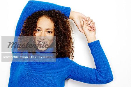 Portrait of smiling woman, studio shot
