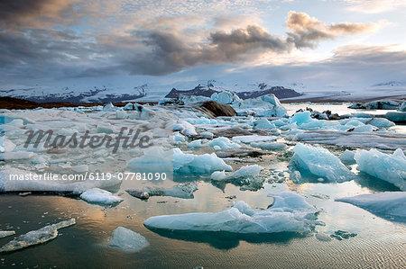 Sunset over Jokulsarlon, a glacial lagoon at the head of the Breidamerkurjokull Glacier on the edge of the Vatnajokull National Park, South Iceland, Iceland, Polar Regions