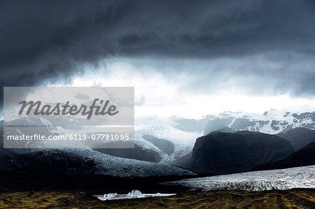Looking towards Fjallsarlon, a glacial lake fed by Fjallsjokull at the south end of the Vatnajokull icecap. near Jokulsarlon, South Iceland, Iceland, Polar Regions
