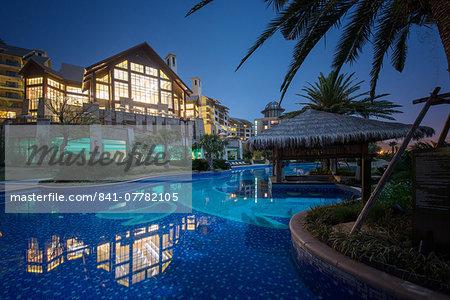 Exterior view of Hilton Hangzhou Qiandao Lake Resort with pool, captured under a full moon, Chun An, Zhejiang, China, Asia