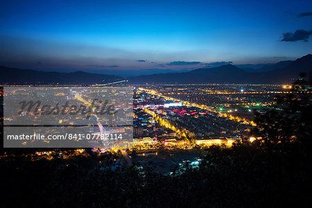 City lights of Lijiang as seen from Elephant Mountain, Lijiang, Yunnan, China, Asia