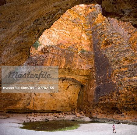 Cave in waterfall undercut, Cathedral Gorge in Purnululu National Park (Bungle Bungle), UNESCO World Heritage Site, Western Australia, Australia, Pacific