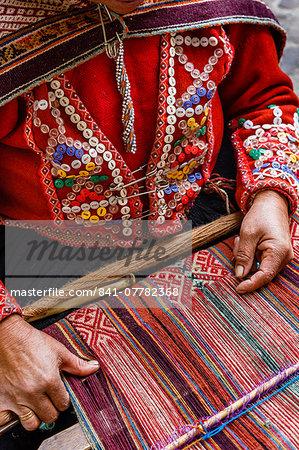 Quechua woman weaving a traditional textile, Cuzco, Peru, South America