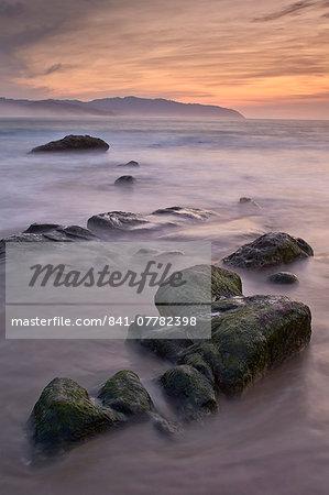 Rocks at sunset, Pacific City, Oregon, United States of America, North America