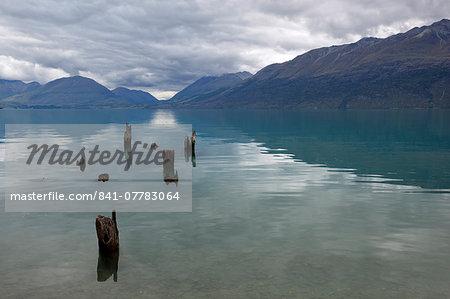 Old pier posts on Lake Wakatipu, Glenorchy, Otago, South Island, New Zealand, Pacific