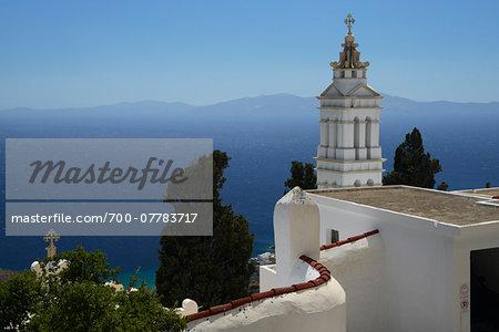 Scenic view of white Greek orthodox church near the sea, Tinos, Cyclades Islands, Greece