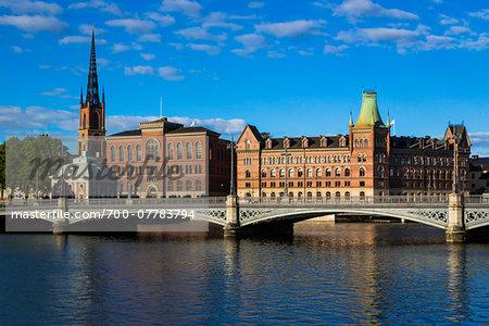 Vasa Bridge on the Norrstrom River in front of (from left to right) Riddarholmen Church, Gamla Riksarkivet (Old National Archives Building) and Norstedt Building, Riddarholmen, Stockholm, Sweden