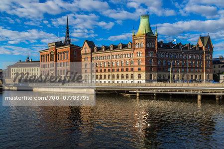 Centralbron Bridge along the Norrstrom River with the Gamla Riksarkivet (Old National Archives building) and Norstedt Building, Riddarholmen, Stockholm, Sweden
