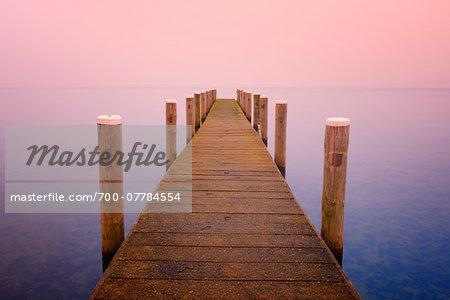 Wooden Jetty on lake, Schweriner Innersee, Schwerin, Western Pomerania, Mecklenburg-Vorpommern, Germany