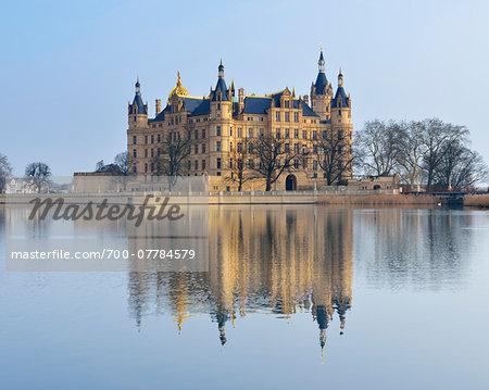 Schwerin Castle reflected in Schwerin Lake, Schwerin, Western Pomerania, Mecklenburg-Vorpommern, Germany