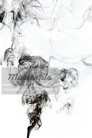 Black smoke on white background, studio shot