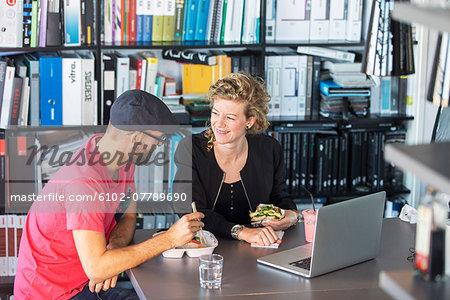 Colleagues having lunch break