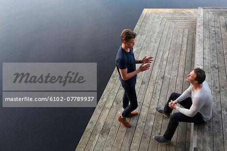 Two men talking on jetty