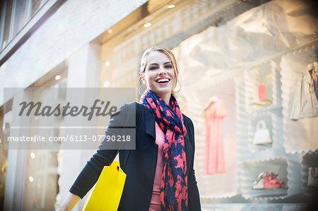 Woman shopping on city street