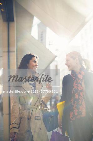 Women walking down city street together