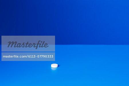 Close up of prescription pill on blue counter