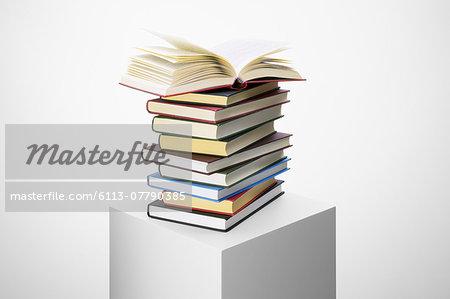 Stack of books on pedestal