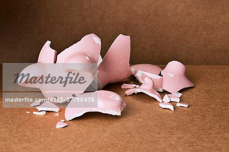 Broken piggy bank on counter