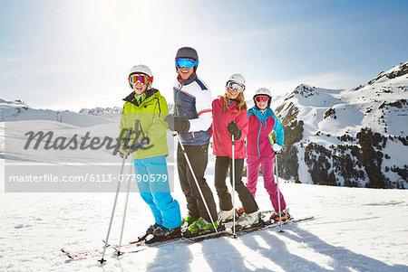 Family skiing on mountain top