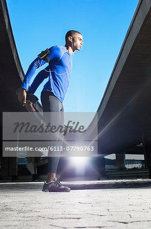 Man stretching before exercising