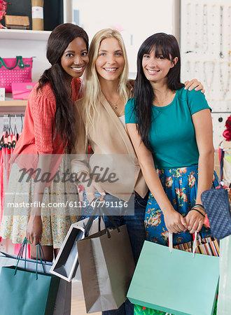 Women carrying shopping bags in clothing store