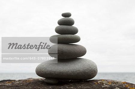 Six coastal stones balanced on top of each other