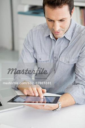 Office worker using digital tablet