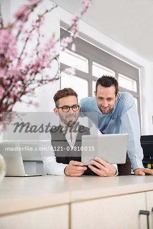 Men office planning meeting tablet computer
