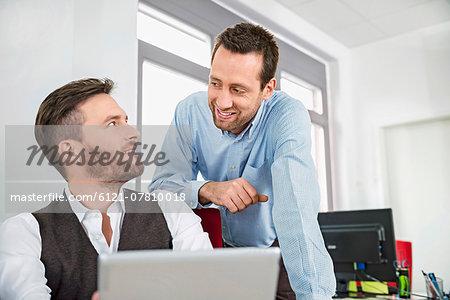 Men two meeting talking tablet computer