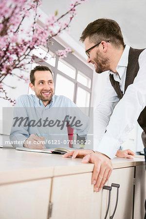 Working office colleague talking meeting men