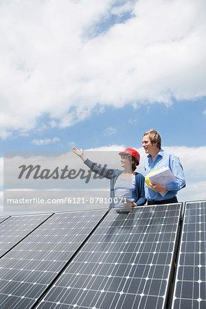 Female engineer client solar roof panel energy