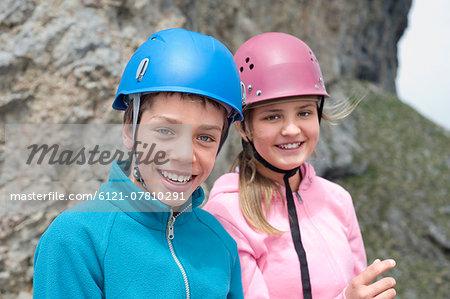Portrait teenage boy girl climbing Alps helmet