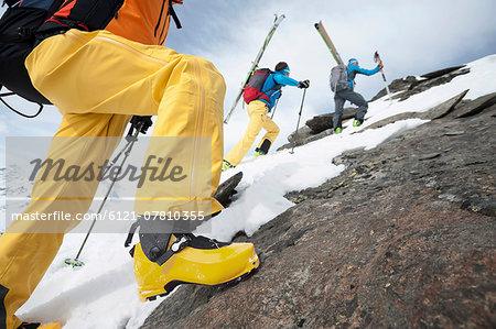 Rock climbing cross-country skiers snow