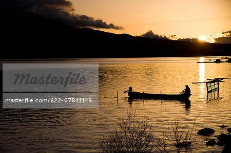 Boat at the lake at sunset
