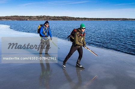 Two men ice-skating