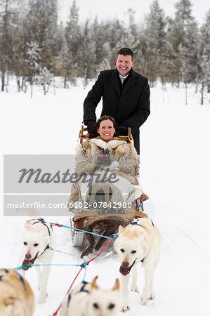 Newlywed couple on sleigh