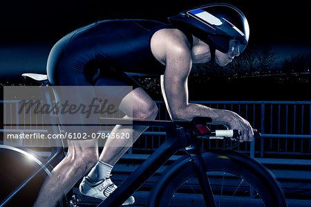 Man cycling at night