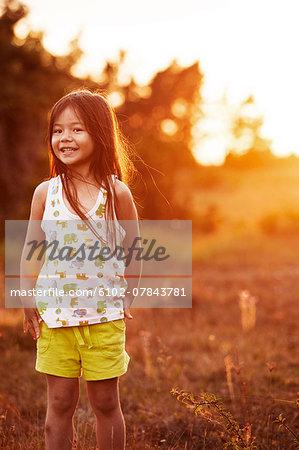 Girl looking at camera, sunset