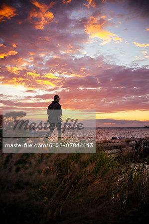 Man walking at sunset