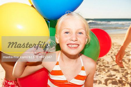 Portrait of girl (6 - 8 years) on beach