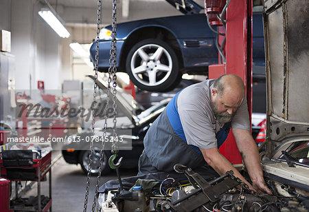Mechanic rebuilds auto engine