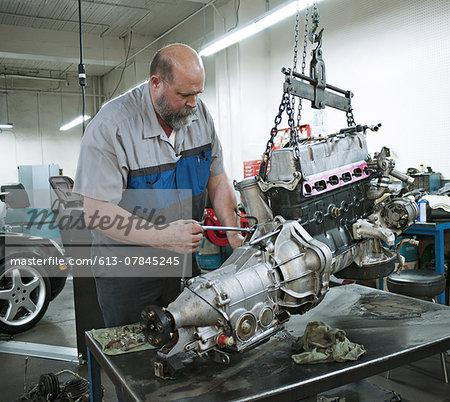 Mechanic opens auto engine